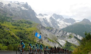 Astana lead the peloton up Col d'Izoard, shielding Vincenzo Nibali behind them.
