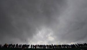 Spectators watched under heavy skies.