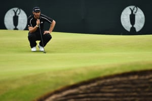 Dustin Johnson lines up his putt on the second green. His challenge faded with a hat-trick of bogeys but he is tied in third place with Sergio Garcia.