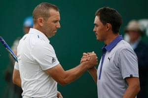Sergio Garcia and Rickie Fowler shake hands on the 18th green after finishing their third round.