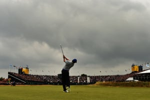 Rory McIlroy plays his second shot on the 18th hole. 'I was just sort of waiting for those two holes,' McIlroy said. 'I felt like I was driving the ball well, and if I could drive it on the fairway on 16 and 18, I knew that I would have irons into the greens for my second shots'.