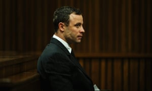 Oscar Pistorius listens to evidence from the dock today.