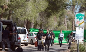 Israeli policemen search the area after a body of a Palestinian youth was found in a Jerusalem's forest area.