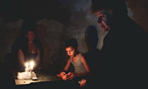 Sveta Serdyukova and her son Nikita shelter in the basement during shelling