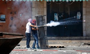 Palestinians set off fire works towards Israeli police during clashes in Shuafat.
