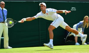 Novak Djokovic returns to Marin Cilic.