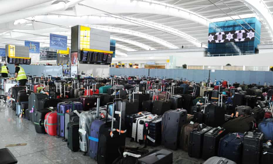Baggage piles up at Heathrow Airport Terminal Five after the baggage system broke down.