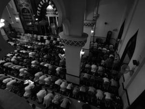 'Muslims during taraweeh prayer in Ridwanul-islam mosque, Bangkok.'