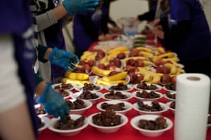 'Preparing dates, fast. Volunteers preparing dates and food in time for iftar (breaking of fast) at the community run Ramadan Tent project in London.'