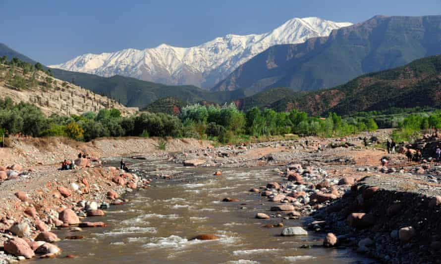 Ourika river at Tnine with snow capped Atlas Mountains, which line south-western Morocco.