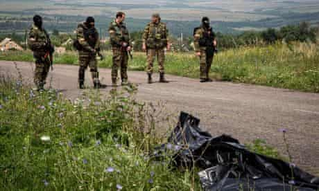 Armed separatists at MH17 crash site in Ukraine