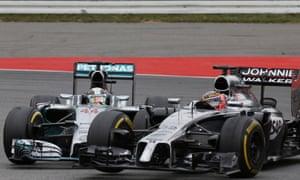 Lewis Hamilton taps Jenson Button during the German Grand Prix at Hockenheim.