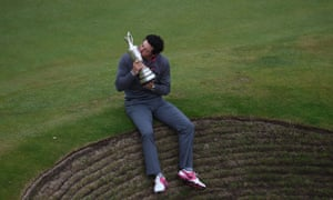 Rory McIlroy celebrates with the Claret Jug after his two-stroke victory in the Open Championship