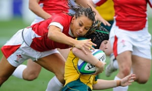 Wales full-back Non Evans, who is taking part in wrestling at the coming Commonwealth Games, tries to tackle Nicole Beck.