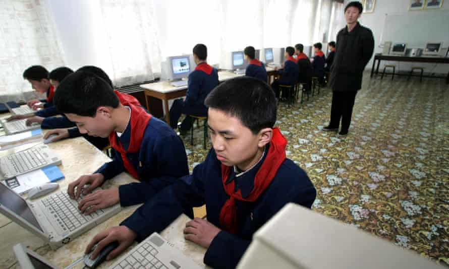 A teacher (R) watches over his pupils at a computer class at a high school in the North Korean capital of Pyongyang, in 2005. Internet access is extremely restricted in North Korea.