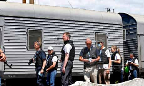 OSCE inspectors document the bodybags from MH17 at Torez train station