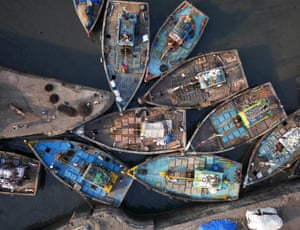 A knot of fishing boats at the entrance to Sassoon Dock, Mumbai