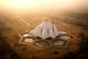 The Lotus Temple, dotted with pigeons at sunrise. Designed by an Iranian exile, the building serves as the centre of the Bahai'i faith in Delhi.