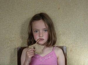 Munch: My sister munching on a slice of walnut bread.