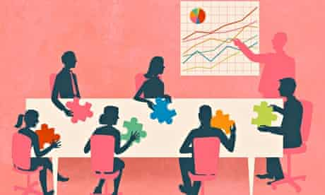 Business people with multicolored jigsaw