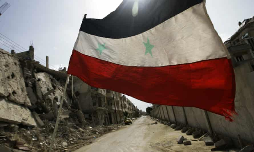 Syrian flag flutters in Homs