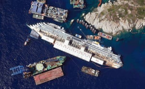 26 August 2012: An aerial view shows the Costa Concordia as it lies on its side next to Giglio Island taken from an Italian navy helicopter