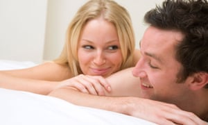 A young couple happy in bed.