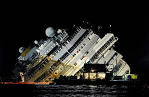 16 September 2013:  Engineers work on the wreckage of the Costa Concordia during the night