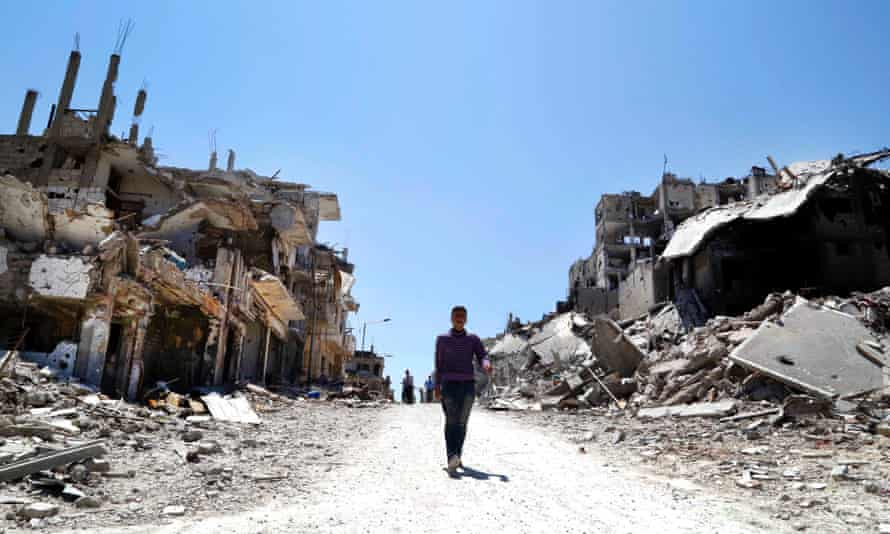 Residents return to inspect their homes in the Wadi Al-Sayeh neighbourhood of Homs
