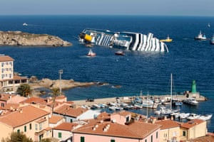 14 January 2012: The Costa Concordia leans on its starboard side after running aground on the tiny Tuscan island of Giglio, Italy