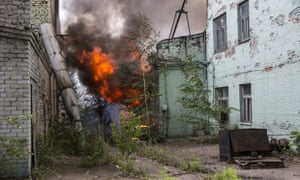 A fire burns in a factory complex hit during fighting between pro-Russia rebels and Ukrainian government troops on July 21, 2014 in Donetsk.