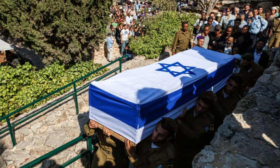 The flag wrapped coffin of a staff sergeant is carried by soldiers of the IDF Golani Brigade.