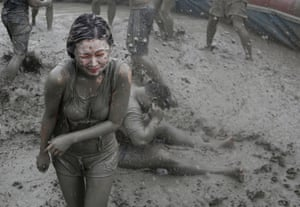 Fun at thr Boryeong Mud Festival - at Daecheon beach, South Korea. Around 2 to 3 million tourists visit the annual mud festival