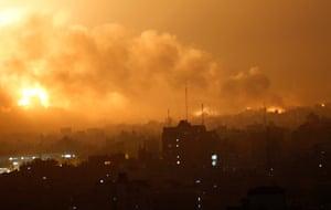Smoke rises as flames spread across buildings after Israeli strikes in the Shijaiyah neighborhood in Gaza City