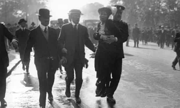 Emmeline Pankhurst, being arrested at a Suffragette protest in May 1914.