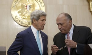 US secretary of state John Kerry and Egypt's foreign minister Sameh Shukri talk before making statements to reporters after Kerry met with Shukri and Egyptian President Abdel-Fattah el-Sissi at the presidential palace in Cairo, on 22 July, 2014.