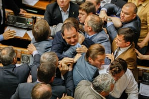 MPs scuffle during a voting session in the Ukrainian Parliament, the Verkhovna Rada, in Kiev, Ukraine