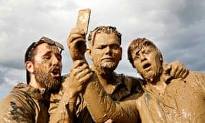 Muddy revellers at Glastonbury this summer take a selfie.