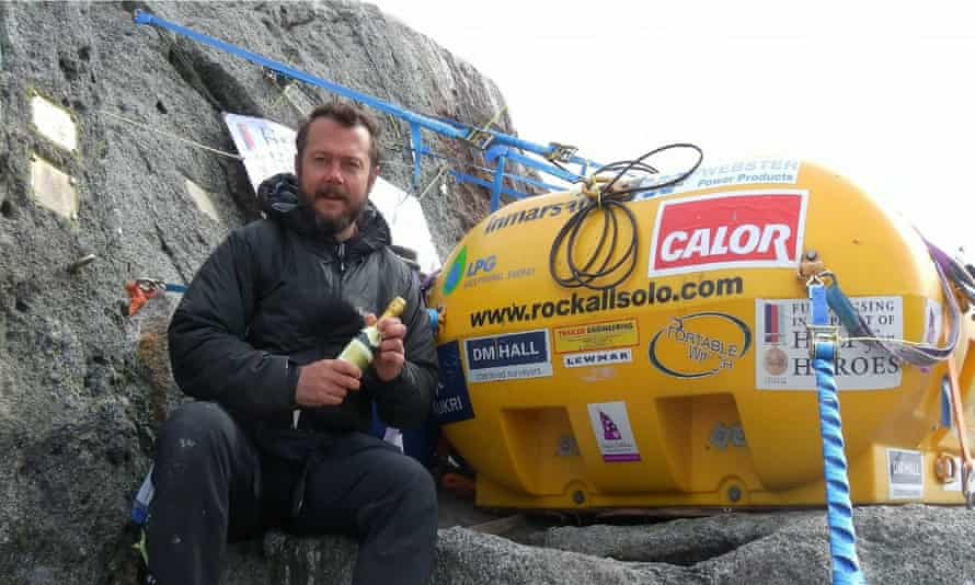 Nick Hancock on Rockall celebrates setting new occupation records on the isolated Atlantic islet with a bottle of champagne.