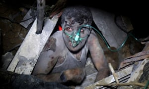 A member of the Palestinian Selam family of Khan Yunis, Gaza, rescued from under wreckage of house