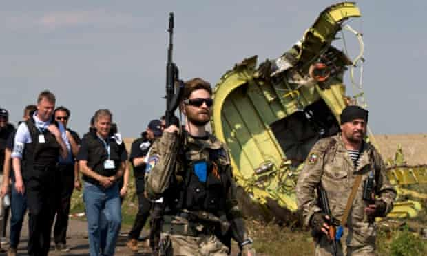 Rebels followed by members of the OSCE mission at plane wreckage ukraine mh17 malaysia