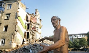 Ukrainain retired mined Viktor Stepanenko, 69, explains what's hapened to him and his family in front of his destroyed blockhouse in the city of Snizhne