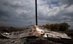 Flowers lie on the wrecked fuselage at the crash site of Malaysia Airlines Flight 17, near Grabovo. ukraine mh17