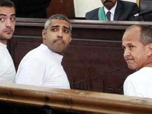 Al-Jazeera journalists Baher Mohamed, left, Canadian-Egyptian Mohammed Fahmy, center, and Australian Peter Greste