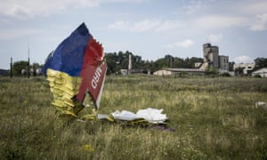 GRABOVO, UKRAINE - JULY 22:  Wreckage from Malaysia Airlines flight MH17 lies in a field on July 22, 2014 in Grabovo, Ukraine.