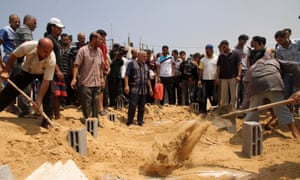 members of the Kelani family, killed overnight by an Israeli strike in Gaza City, during their funeral in Beit Lahiya, northern Gaza Strip.   Ibrahim Kelani, 53, his wife Taghreed and their five children, were killed in the strike on a Gaza City highrise.