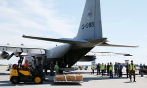 MH17 victims loaded onto a transport plane at Kharkiv airport