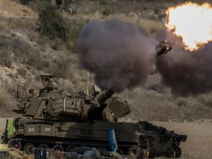 An Israeli self-propelled howitzer fires a shell to the Gaza Strip from southern Israel as the Operation Protective Edge continues on 22 July, 2014.