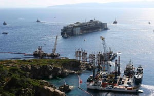23 July 2014: The ship starts to move anti-clockwise, before being towed away from Giglio Island. The liner is being taken to a shipbreakers in the port of Genoa