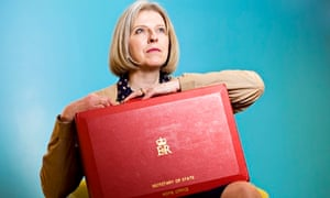 'Dedicated to the job': Theresa May with her Home office red box.